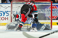 KELOWNA, BC - NOVEMBER 20: Leif Mattson #28 of the Kelowna Rockets loses his footing as Brock Gould #33 of the Victoria Royals covers the puck and makes a save at Prospera Place on November 20, 2019 in Kelowna, Canada. (Photo by Marissa Baecker/Shoot the Breeze)