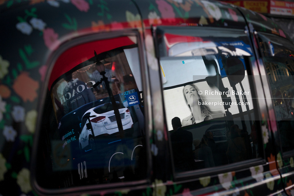 Advertising reflected in taxi windows at dusk in Piccadilly Circus, on 1st December 2016, in Piccadilly Circus, London England. (Photo by Richard Baker / In Pictures via Getty Images)