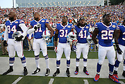 The Buffalo Bills stand at attention during the playing of the National Anthem before the 2014 NFL Pro Football Hall of Fame preseason football game against the New York Giants on Sunday, Aug. 3, 2014 in Canton, Ohio. The Giants won the game 17-13. ©Paul Anthony Spinelli