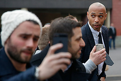 Former France international Thierry Henry is mobbed by fans as he arrives at Stamford Bridge in his role as a television pundit - Photo mandatory by-line: Rogan Thomson/JMP - 07966 386802 - 11/03/2015 - SPORT - FOOTBALL - London, England - Stamford Bridge - Chelsea v Paris Saint-Germain - UEFA Champions League Round of 16 Second Leg.