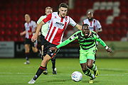Forest Green Rovers Drissa Traoré(4) is fouled by Cheltenham Town's Alex Davey(29) during the EFL Trophy match between Cheltenham Town and Forest Green Rovers at Whaddon Road, Cheltenham, England on 3 October 2017. Photo by Shane Healey.