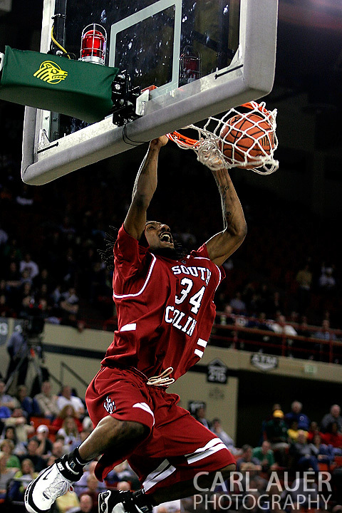 24 November 2005:Junior forward Renaldo Balkman (34) from the University of South Carolina slams the ball home in the Gamecock's 65 - 60 victory over the University of Alaska Anchorage Seawolves in the first round of the Great Alaska Shootout at the Sullivan Arena in Anchorage Alaska.