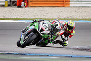 Leon Haslam (91) JG Speedfit Kawasaki leads Shane Byrne (67) Be Wiser Ducati on the last lap in race one at the BSB Championship at the TT Circuit,  Assen, Netherlands on 2nd October 2016. Photo by Nigel Cole.