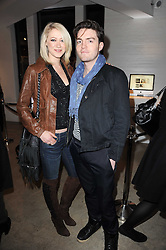 SIOBHAN HEWLETT and TOM BURKE at the Polo Jeans Co. hosted Art Stars Auction in support of the Teenage Cancer Trust held at Phillips de Pury & Co, Howick Place, London on 6th December 2010.