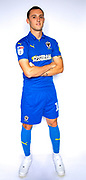 AFC Wimbledon midfielder Dylan Connolly (16)\ during the official team photocall for AFC Wimbledon at the Cherry Red Records Stadium, Kingston, England on 8 August 2019.