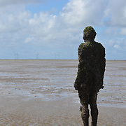 Another Place is a piece of modern sculpture by Sir Antony Gormley. It consists of 100 cast iron sculptures of the artist's own body, facing towards the sea.<br />
