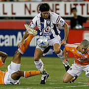 Pachuca's Bruno Marioni tries to split the defense of the Dynamo's Wade Barrett and Ricardo Clark during the semifinals game of the Super Liga 2008 soccer tournament at Robertson Stadium on Tuesday, July 29, 2008, in Houston.