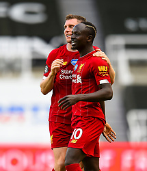 LIVERPOOL, ENGLAND - Sunday, July 26, 2020: Liverpool's Sadio Mané (R) celebrates with James Milner after scoring the third goal during the final match of the FA Premier League season between Newcastle United FC and Liverpool FC at St. James' Park. The game was played behind closed doors due to the UK government's social distancing laws during the Coronavirus COVID-19 Pandemic. Liverpool won 3-1 and finished the season as Champions on 99 points. (Pic by Propaganda)