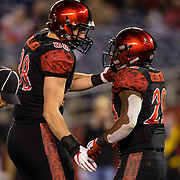 10 November 2018: San Diego State Aztecs tight end Daniel Bellinger (88) congratulates running back Juwan Washington (29) after scoring a touchdown in the second quarter. The Aztecs lost 27-24 to UNLV Saturday night at SDCCU Stadium falling a game behind Fresno State in the conference standings.