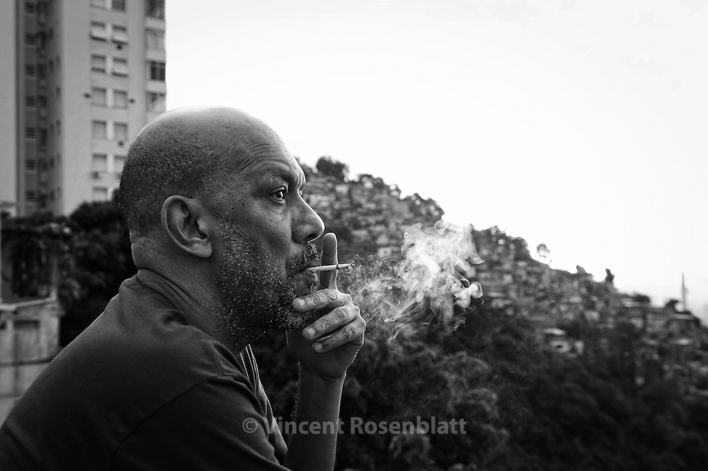 """Paulo Lins, Brazilian writer of 'City of God"""" and 'Since Samba is Samba"""". Here on the top of Santa Teresa district, wherefrom all favelas and places where the Samba is born in Zona Norte can be seen.."""