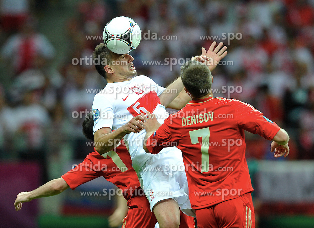 Warsaw 12/06/2012.POLAND, WARSAW .Dariusz Dudka  of Poland fights for the ball with Igor Denisov of Russia during the Euro 2012 football championships match Poland vs. Russia, on June 12, 2012 at the National Stadium in Warsaw. .Photo by: Piotr Hawalej / WROFOTO
