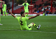 Hudderfield Town defender Tommy Smith trying to look for a penalty during the Sky Bet Championship match between Brentford and Huddersfield Town at Griffin Park, London, England on 19 December 2015. Photo by Matthew Redman.