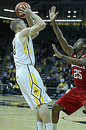 January 26, 2012: Iowa Hawkeyes guard Matt Gatens (5) puts up a shot as Nebraska Cornhuskers guard Caleb Walker (25) defends during the NCAA basketball game between the Nebraska Cornhuskers and the Iowa Hawkeyes at Carver-Hawkeye Arena in Iowa City, Iowa on Thursday, January 26, 2012.
