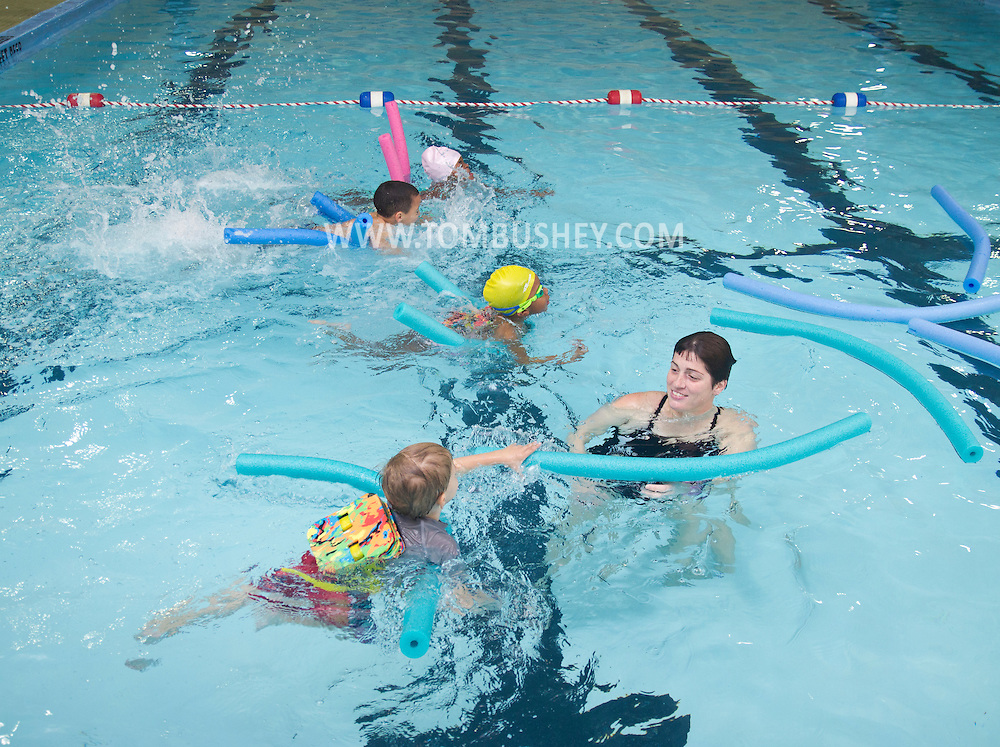 Middletown, New York - Children chase after noodles during swimming lessons at the YMCA of Middletown on Nov. 4, 2014.