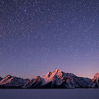 The Tetons under the stars at first moonlight.