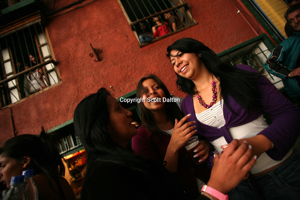 Friends have a few beers at a popular bar for university students, located just across the street from a university in La Candelaria, Bogota?s oldest neighborhood, on Friday, February 22, 2008. (Photo/Scott Dalton)
