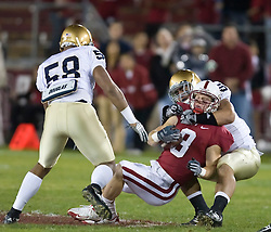November 28, 2009; Stanford, CA, USA;  Stanford Cardinal wide receiver Ryan Whalen (8) is tackled by Notre Dame Fighting Irish linebacker Manti Te'o (5) during the first quarter at Stanford Stadium.