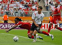 Photo: Glyn Thomas.<br />England v Trinidad & Tobago. Group B, FIFA World Cup 2006. 15/06/2006.<br /> England's Michael Owen (C) and Trinidad & Tobago's Dennis Lawrence (L).