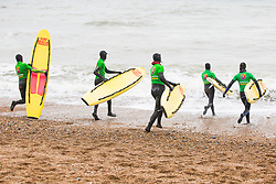 © Licensed to London News Pictures. 24/03/2018. Brighton, UK. Members of the Brighton Surf Life Saving Club take part in their weekly training session in the sea as milder weather is hitting Brighton and Hove. Photo credit: Hugo Michiels/LNP