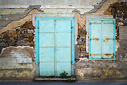 Weathered wall and blue iron gate, Brod, Croatia