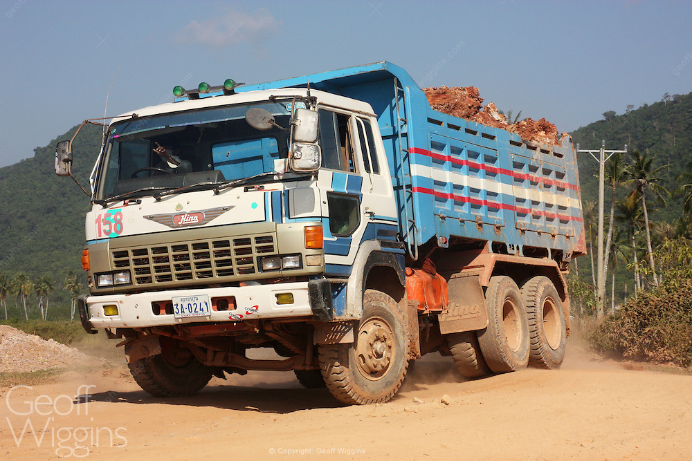 Cambodian dump truck transporting rock during road construction work Svey Rieng in southern Cambodia