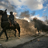 02/01/2009. Clashes in east Jerusalem.....An Israeli horseman  walks by a burning tire during clashes with Palestinian in East Jerusalem, as they demonstrates against Israel's military operation in Gaza, January 02, 2008. Photo by Michal Fattal. ..