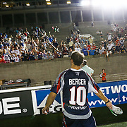 Stephen Berger #10 of the Boston Cannons throws his cleats into the stands following the game at Harvard Stadium on August 9, 2014 in Boston, Massachusetts. (Photo by Elan Kawesch)