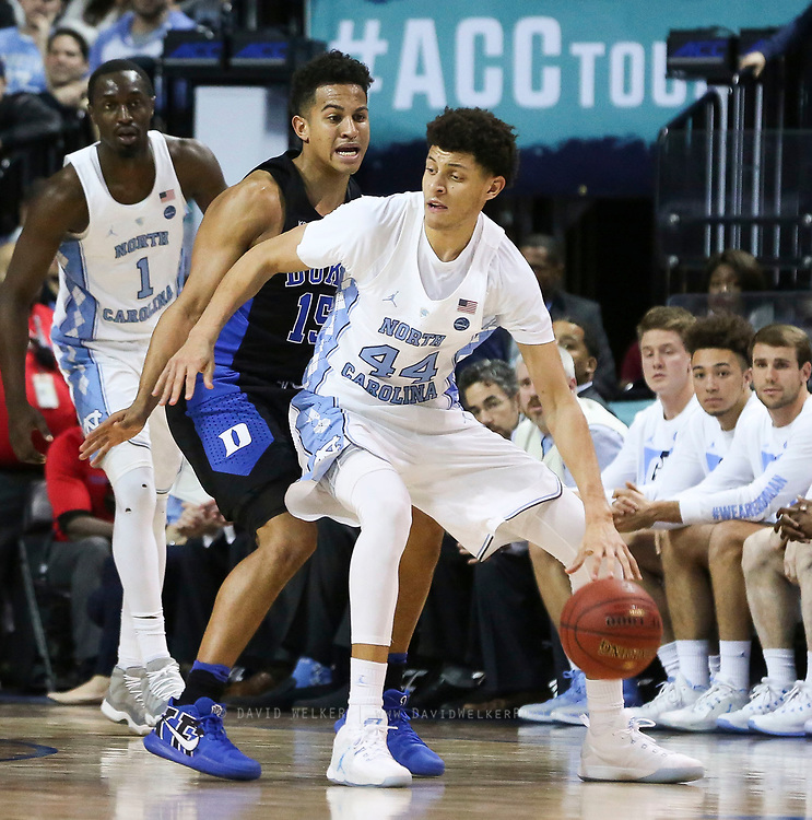 North Carolina forward Justin Jackson (44) is pressured by Duke guard Frank Jackson (15) during the semifinals of the 2017 New York Life ACC Tournament at the Barclays Center in Brooklyn, N.Y., Friday, March 10, 2017. (Photo by David Welker, theACC.com)