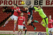 Adam Davies (Barnsley) punches the ball clear off the head of Matt Mills (Nottingham Forest) and Sam Winnall (Barnsley) during the EFL Sky Bet Championship match between Barnsley and Nottingham Forest at Oakwell, Barnsley, England on 25 November 2016. Photo by Mark P Doherty.