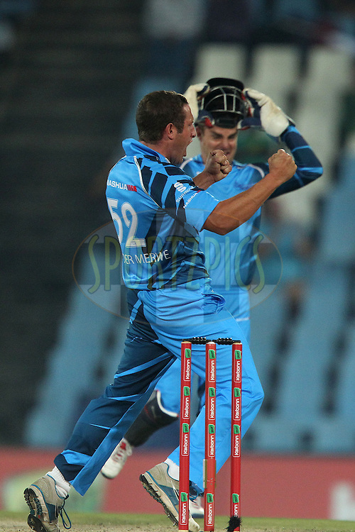 Roelof van der Merwe celebrates the wicket of Michael Lumb of the Sydney Sixers during the 2nd semi final of the Karbonn Smart CLT20 South Africa between The Sydney SIxers and the The Titans held at Supersport Park in Centurion, Gauteng on the 26th October 2012..Photo by Ron Gaunt/SPORTZPICS/CLT20.