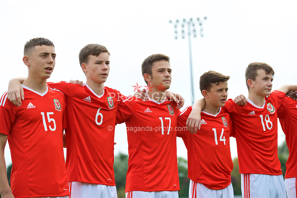 NEWPORT, WALES - Sunday, September 24, 2017: Wales' Callum King-Harmes, Owen Hesketh, Joshua Francombe, Owen Beck and Liam Higgins line-up to sing the national anthem before an Under-16 International friendly match between Wales and Gibraltar at the Newport Stadium. (Pic by David Rawcliffe/Propaganda)