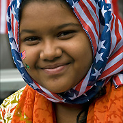 Head and shoulders portrait of Aliza Fatima 12 year old  Pakistani Muslim American teenage girl the Muslim  festival in Madison Square Park after the Muslim Day Parade.<br />
