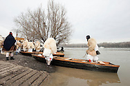 Busó carnival, Mohács, Hungary. On the last Sunday before Lent, the Busós cross the Danube in dug-out wooden boats before gathering for a procession through the town (7 February 2016). The Busó carnival or Busójárás is inscribed on the UNESCO list of Intangible Cultural Heritage. © Rudolf Abraham