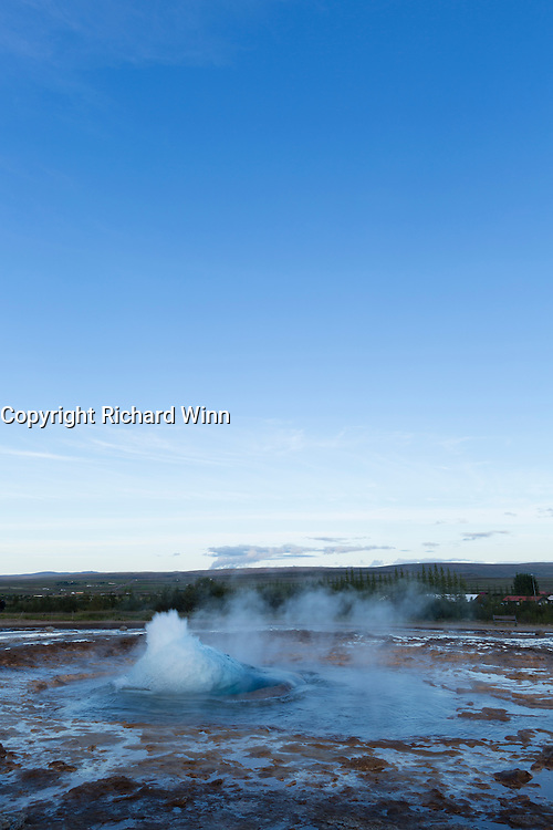 Strokkur geyser erupting during a fine summer's evening in southern Iceland.