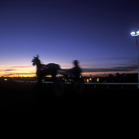 Canada, Alberta, Edmonton, Blurred image of harness races at Northland Park on summer evening