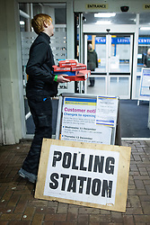 © Licensed to London News Pictures . 12/12/2019. Bury, UK. Staff working overnight at the count for seats in the constituencies of Bury North and Bury South in the 2019 UK General Election , bring in a Domino's Pizza takeaway to Castle Leisure Centre in Bury . Photo credit: Joel Goodman/LNP