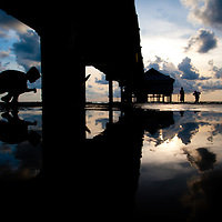 CLEARWATER BEACH, FL -- August 1, 2011 -- Children play under the Clearwater Beach Pier 60 after a storm. (PHOTO / CHIP LITHERLAND)