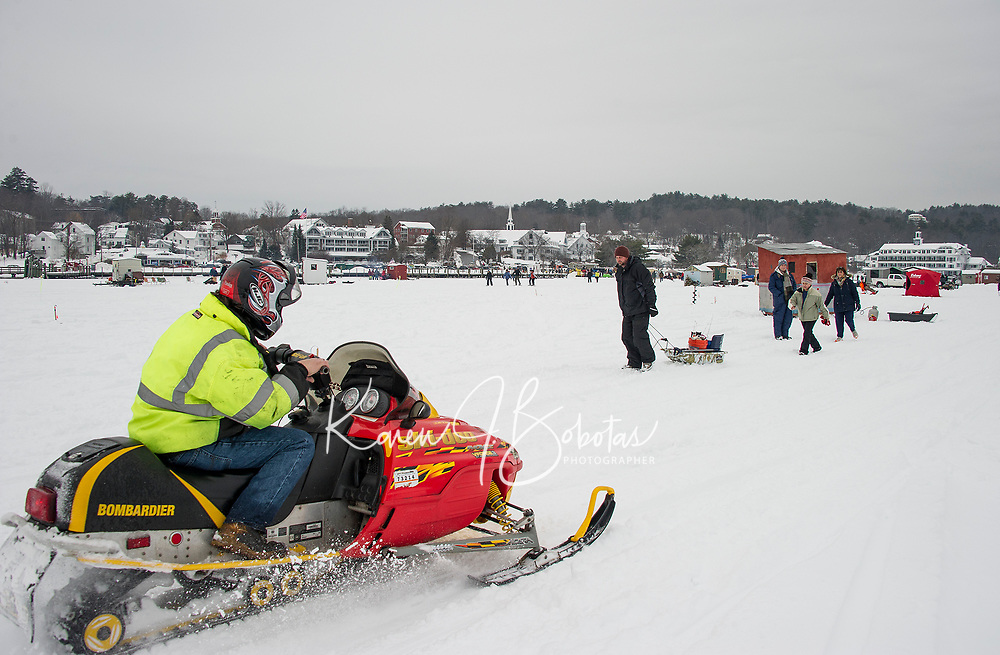 Meredith Bay Village saw a steady flow of winter enthusiasts over the weekend at the annual Great Meredith Rotary Ice Fishing Derby.  (Karen Bobotas/for the Laconia Daily Sun)