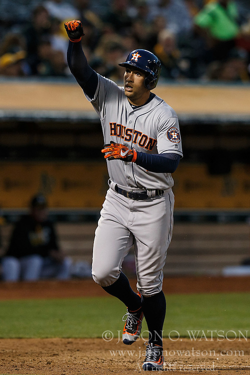 OAKLAND, CA - JULY 19:  George Springer #4 of the Houston Astros celebrates after hitting a home run against the Oakland Athletics during the fifth inning at the Oakland Coliseum on July 19, 2016 in Oakland, California. The Oakland Athletics defeated the Houston Astros 4-3 in 10 innings.  (Photo by Jason O. Watson/Getty Images) *** Local Caption *** George Springer