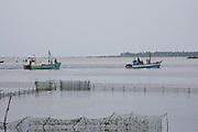 Fishing boats and Fish traps on Jaffna lagoon.