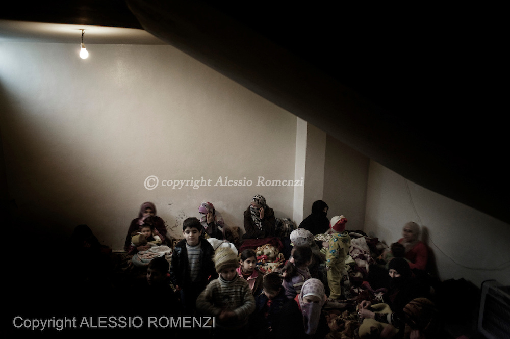 SYRIA, HOMS, Baba Amro: Syrian women and children are seen in an underground room in Baba Amro, southern neighborhood of Homs, after Al Assad Army bombed their houses, on February 07, 2012.  ALESSIO ROMENZI