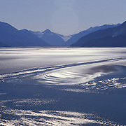 Sun Patterns On Turnagain Arm of Cook Inlet  With Chugach Mountains In Distance Near Portage, Alaska USA