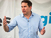 17 AUGUST 2019 - DES MOINES, IOWA: Representative SETH MOULTON (D-MA) answers reporters' questions in the press gaggle at the Iowa State Fair Saturday. Moulton, a US Marine veteran who served in Iraq, is running to be the Democratic candidate for the US Presidency in 2020 and spent Saturday campaigning at the fair. Iowa traditionally hosts the the first selection event of the presidential election cycle. The Iowa Caucuses will be on Feb. 3, 2020.         PHOTO BY JACK KURTZ