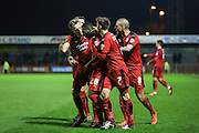 Roarie Deacon of Crawley Town is congratulated by team mates after his winning goal during the Sky Bet League 2 match between Crawley Town and Stevenage at the Checkatrade.com Stadium, Crawley, England on 26 December 2015. Photo by Phil Duncan.