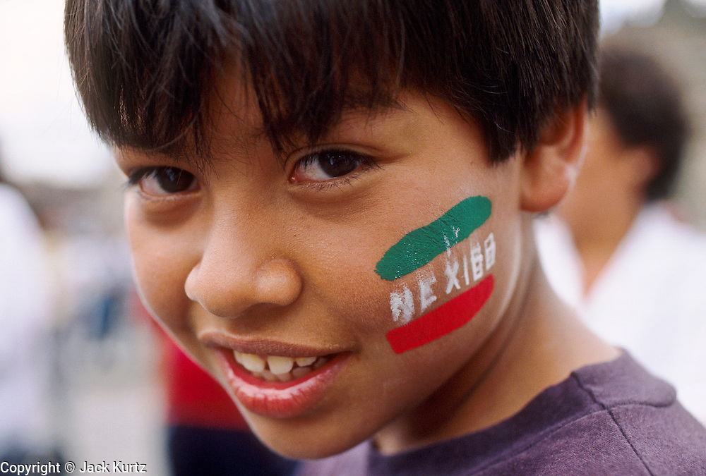 MEXICO CITY, DF, MEXICO: A boy on the Zocalo in Mexico City during Mexican Independence Day celebrations, Sept 16.  PHOTO © JACK KURTZ  family  culture  children patriotism