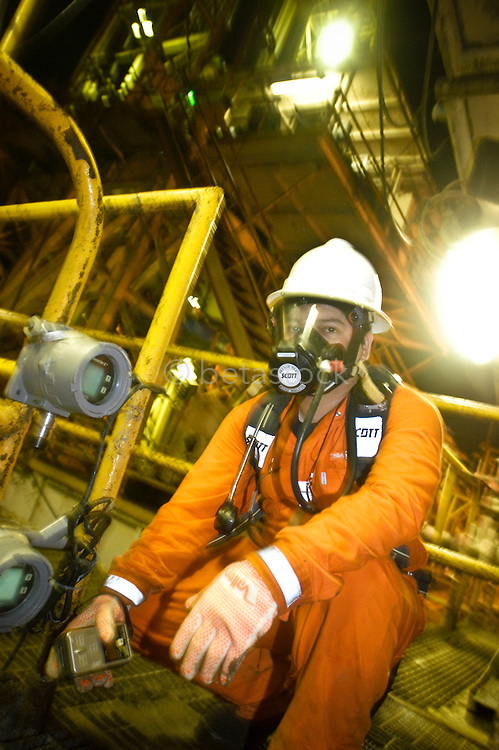 Safety worker checking for gas leaks on a Pemex oil platform in the Golf of Mexico.
