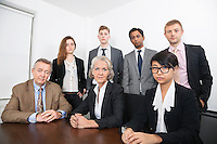 Portrait of confident multiethnic business group at desk in office