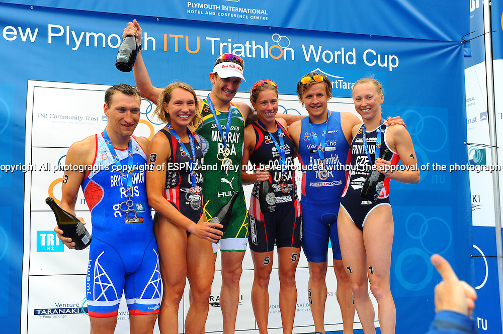 Renee Tomlin, Vendula Fritova,  Kaitlin Donner,with Richard Murray,Alexander Bryukhankov (Rus)and Kristian Blummenfelt (Nor) Celebrate on the podium at the 2015 New Plymouth ITU Triathlon World Cup held at Ngamotu beach New Plymouth Sunday 22nd March.<br /> Photo John Velvin ESPNZ<br /> www.elitesportsphotographynz.com