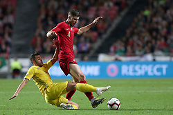 March 22, 2019 - Lisbon, Portugal - Portugal's defender Ruben Dias (R ) vies with Ukraine's forward Junior Moraes during the UEFA EURO 2020 group B qualifying football match Portugal vs Ukraine, at the Luz Stadium in Lisbon, Portugal, on March 22, 2019. (Credit Image: © Pedro Fiuza/ZUMA Wire)