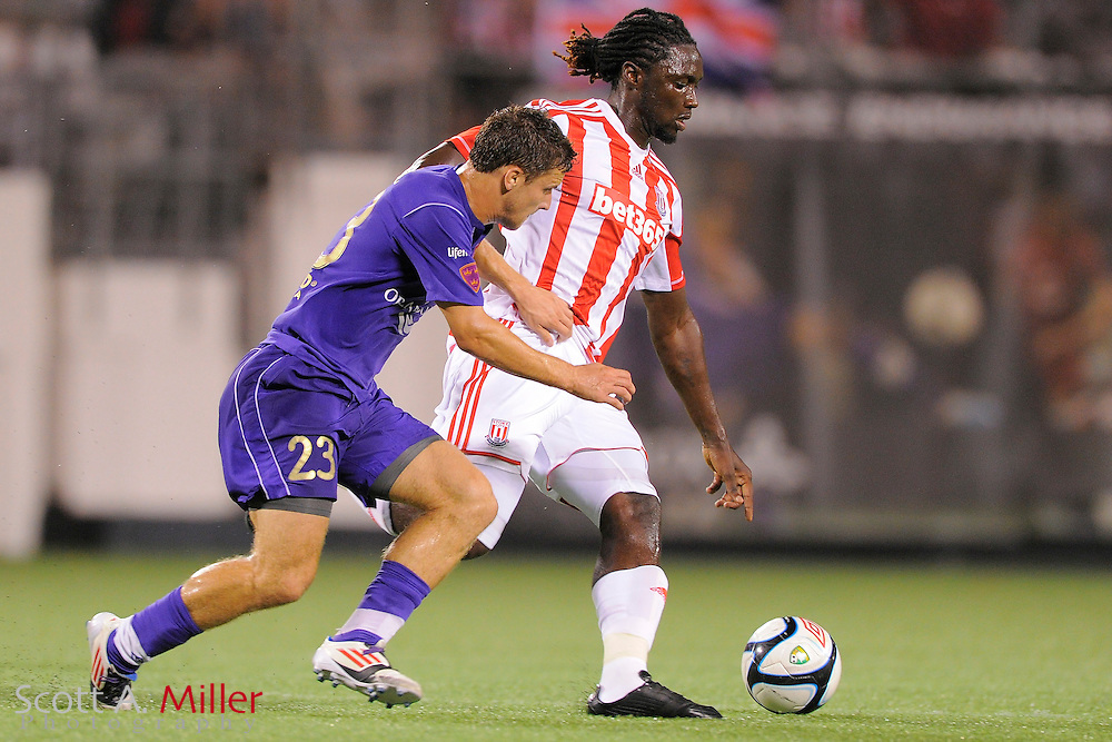 Stoke City Potters forward Kenwyne Jones (9) and Orlando City Lions midfielder Charlie Campbell (23) fight for a ball at the Florida Citrus Bowl on July 28, 2012 in Orlando, Florida. Stoke won 1-0...© 2012 Scott A. Miller.
